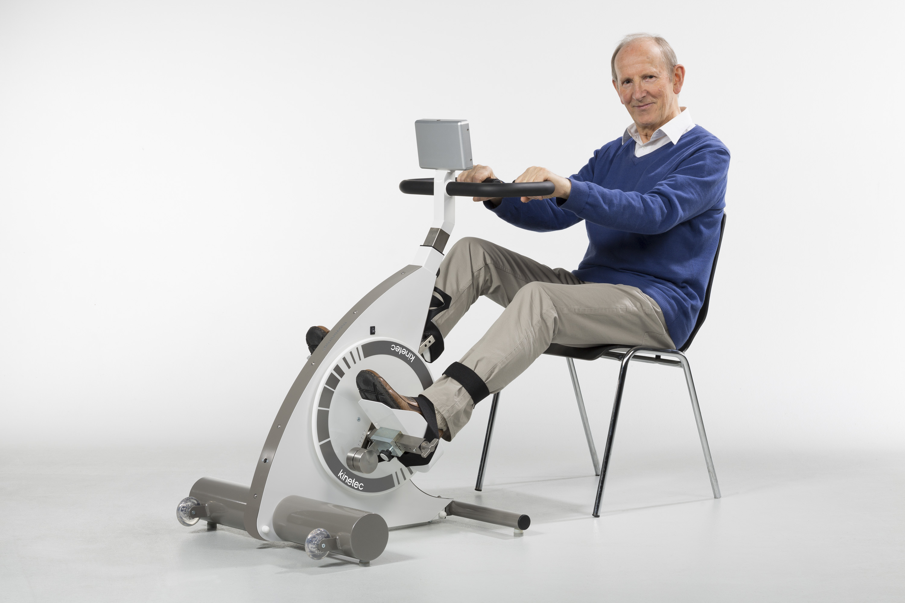 Kinetec Kinevia in use by elderly male in chair