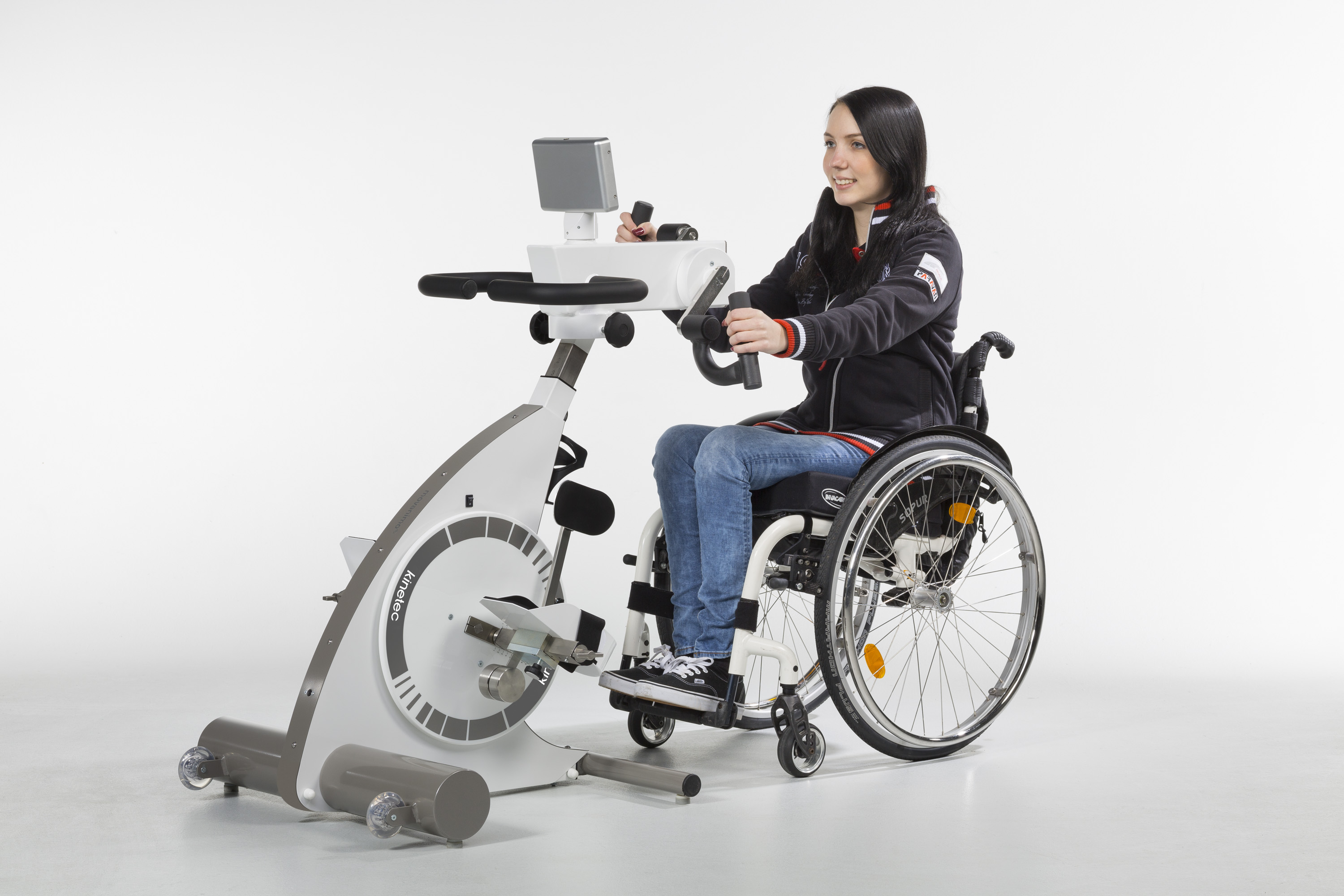 Kinetec Kinevia Duo in use by female in wheelchair